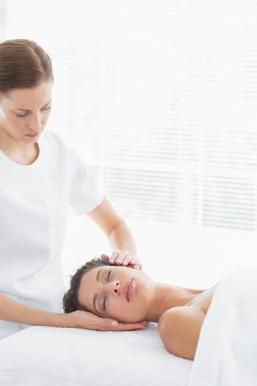 Physical therapist massaging woman