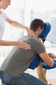 Therapist massaging in hospital