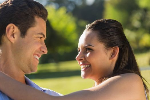 Close-up of a loving and happy couple looking at each other at the park