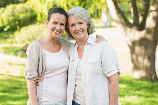 Portrait of a mature woman with daughter at park