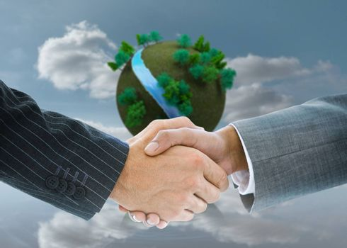 Composite image of business handshake against futuristic earth floating in air