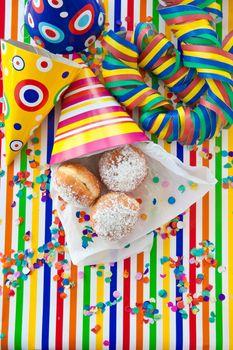 Fresh doughnuts in striped bag