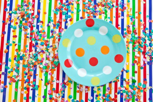 Colorful plate on striped background