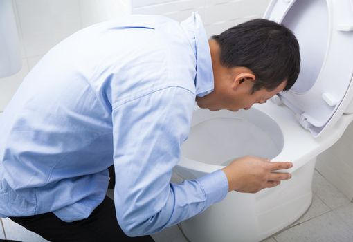 Young man drunk or sick vomiting
