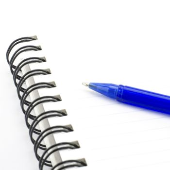blue pen with notebook isolated on white