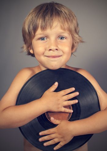 boy with a record smiles