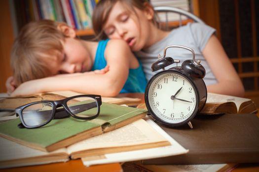 Educational theme: schoolchildren in a classroom.