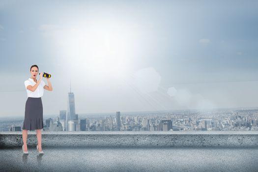 Astonished elegant businesswoman holding binoculars against balcony overlooking city