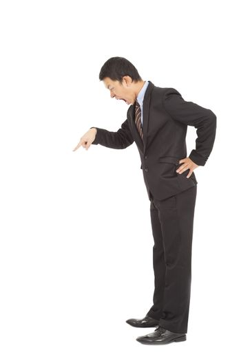 Angry businessman yelling and  pointing