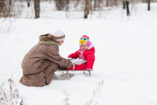 child with mother in winter outdoors