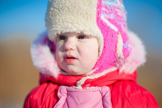 child in winter day outdoors
