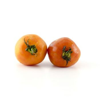 ugly tomato isolated on white background