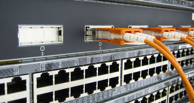 GBIC optic fiber communications equipment installed in a large datacenter.