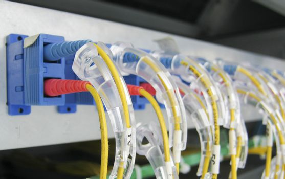 Optic fiber communications equipment installed in a large datacenter.