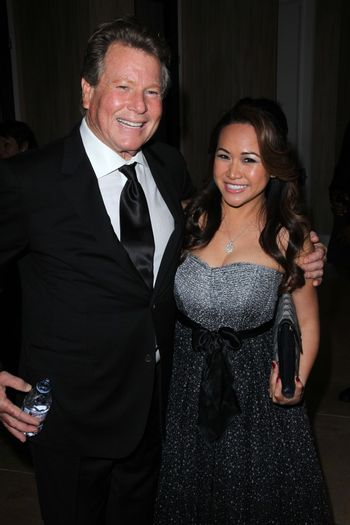 Ryan O'Neal and guest at the John Wayne Cancer Institute Auxiliary's 27th Annual Odyssey Ball, Beverly Hilton, Beverly Hills, CA 04-21-12/ImageCollect