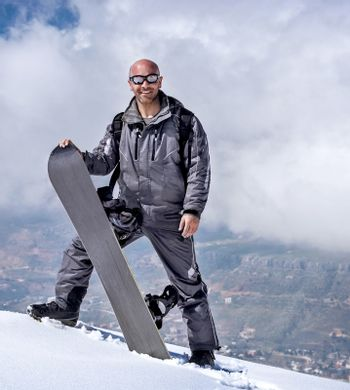 Male snowboarder in the mountains