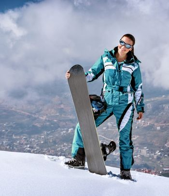 Sporty woman with snowboard