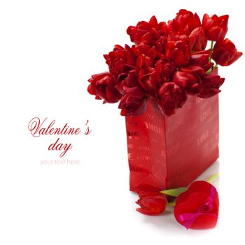 Valentine composition with shopping bag, gift box and fresh tulips over white (with easy removable text)