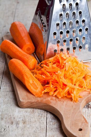 metal grater and carrot