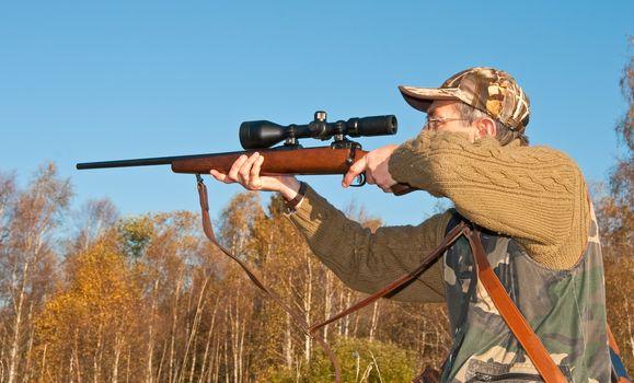 Hunter ready to shoot moose