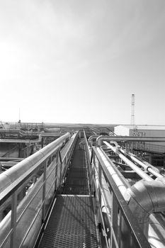 Industrial zone. Steel pipelines, valves and ladders