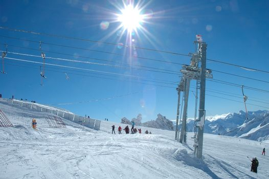 Drag lift and skiers on Hintertux glacier nearby Zillertal valley in Austria