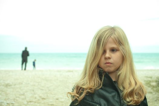 unhappy young girl at the beach
