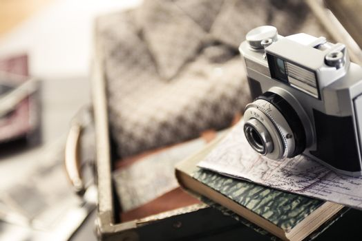 Vintage travel equipment with old camera and suitcase.