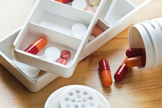Pills and capsules sorted out in pillboxes