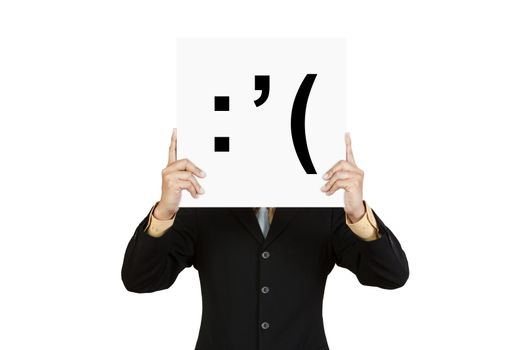 Businessman hold board with cry face emoticon