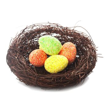 Decorative nest with eggs isolated on white. Easter decor.