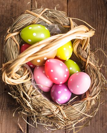 Colorful polka dot eggs in basket, Easter decorations