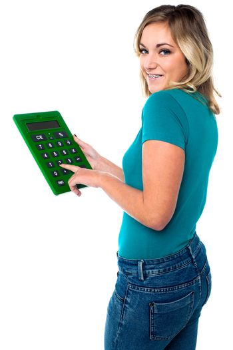 Teen girl using calculator