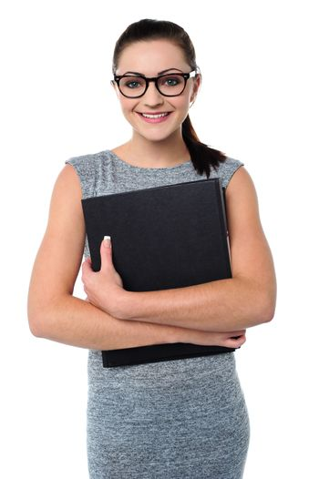 Female assistant holding office file