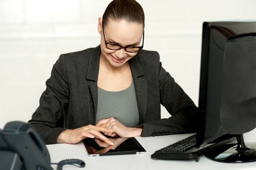 Female executive using tablet pc