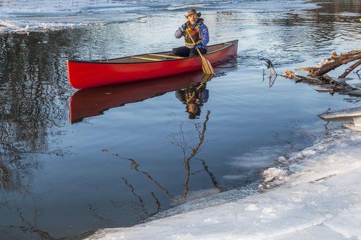 canoe paddling in winter