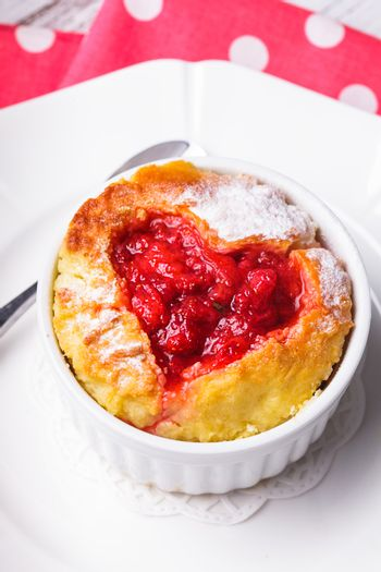 Cupcake with strawberry jam dip in heart shape