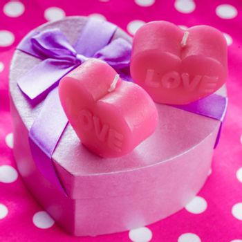 Red scented candle in the shape of heart and gift box