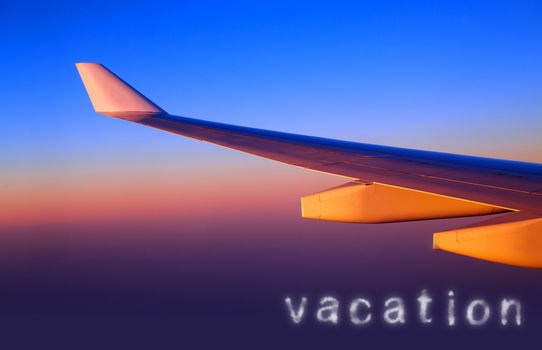 Plane wing in sunset light