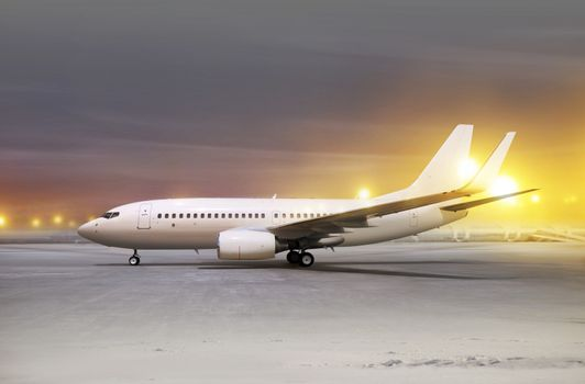 white aircraft in airport at non-flying weather, blowing snow