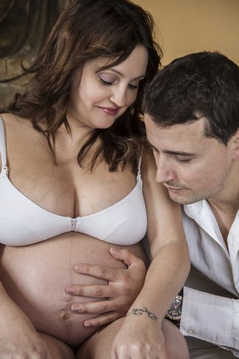 Mom, Family With Pregnant Mother Relaxing On bed Together