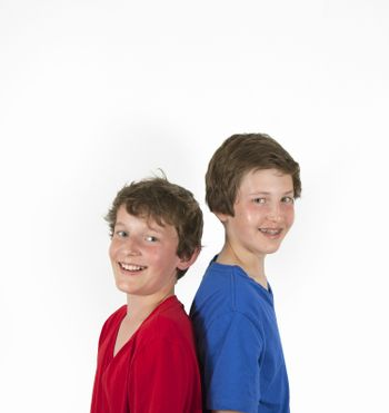 portrait of teenage brothers in red and blue shirt hugging and posing