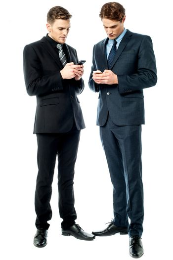Two businessmen using the phone