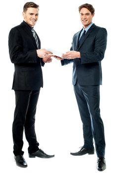 Two businessmen preparing a deal