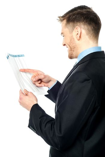 Businessman cross-checking annual reports
