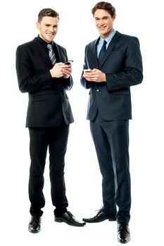 Happy businessmen using cellphone