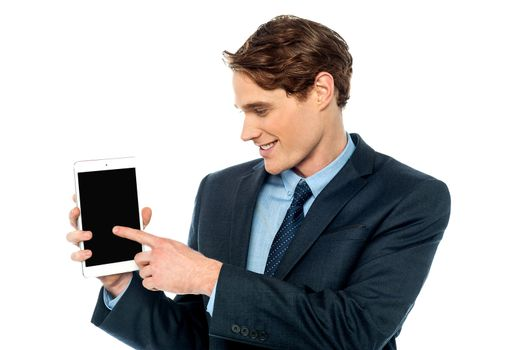 Young business man displaying his new tablet