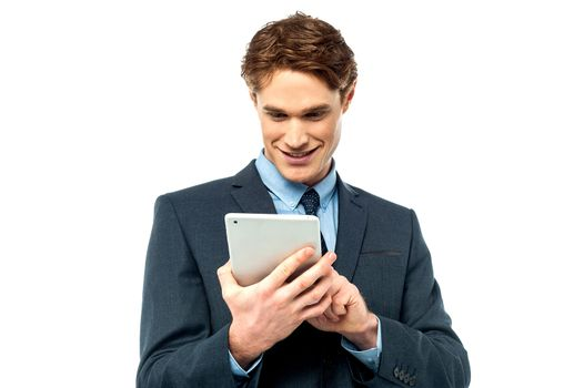 Corporate guy browsing on his tablet pc