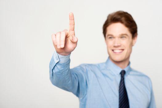 Businessman touching on virtual screen
