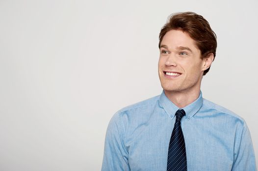 Young corporate guy looking away